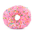 Pink iced doughnut covered in sprinkles on a white background Royalty Free Stock Image