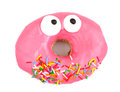 Pink iced doughnut covered in sprinkles on a white background Royalty Free Stock Photos