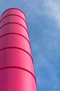 Pink industrial pipe against blue sky background Stock Images