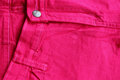 Pink jeans brightly colored while Royalty Free Stock Images
