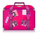 Pink ladys suitcase for travel with stickers on white background Stock Photography