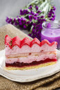 Pink layer cake on wooden table selective focus Royalty Free Stock Photo