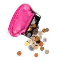 Pink leather purse and several different coins on white background Royalty Free Stock Photos