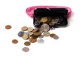 Pink leather purse and several different coins on white background Royalty Free Stock Image