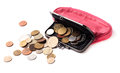 Pink leather purse and several different coins on white background Stock Image