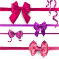 Pink and lilac satin bows isolated on white.