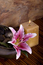 Pink lily flower and candle on bamboo Stock Photos