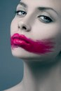 Pink lips paint line blue background Royalty Free Stock Photo