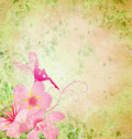 Pink little flower fairy on the green spring or summer grunge background Stock Photography