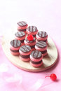 Pink Macarons Filled with Chocolate Ganache and Cherry Confit Royalty Free Stock Photo