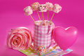 Pink marshmallow pops for valentine with heart shape and pearl sprinkles in cup Royalty Free Stock Photography