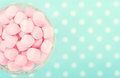 Pink marshmallows on polkadot blue blurred background with vintage nostalgic editing Stock Image