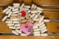 Pink master key on capsule drug wood pattern background Stock Images