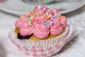 Pink muffin cream blueberry on a table Royalty Free Stock Photos