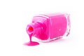 Pink nail polis polish spilled on white background Royalty Free Stock Image