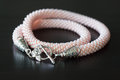 Pink necklace from beads against a dark background close up Royalty Free Stock Photos