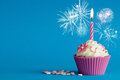 Pink new years cupcake with candle Royalty Free Stock Photo