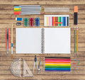 Pink notebook and school or office tools on wood background Royalty Free Stock Photo