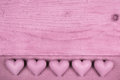 Pink old wooden background with five hearts for a greeting card valentine Stock Photography