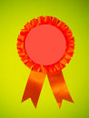 Pink orange first prize ribbon an and with blank center Stock Images