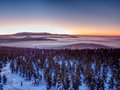 Pink orange sun rise above misty winter mountains Royalty Free Stock Photo