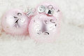 Pink ornaments ornamnets over a white fur background with copyspace Royalty Free Stock Photo