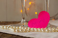 Pink paper heart with love confession and pearls selective focus Stock Photo