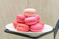 Pink parisian macarons in white disc dish on the shelf Royalty Free Stock Photography