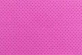 Pink perforated artificial leather background texture a macro shot of Royalty Free Stock Photo