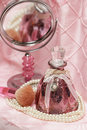 Pink perfume bottle with brush and mirror Stock Photo