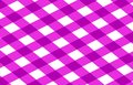 Pink picnic cloth with some squares in it Stock Photo