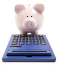 Pink piggy bank and calculator isolated on white background Royalty Free Stock Image