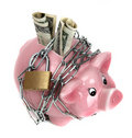 Pink piggy bank with chain and padlock Royalty Free Stock Photo