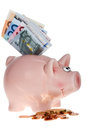 Pink piggy bank with Euro banknotes Royalty Free Stock Photos
