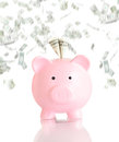 Pink piggy bank with money rain usa one dollar banknotes Royalty Free Stock Photography