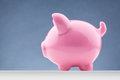 Pink piggy bank side view of a with copy space Stock Photography