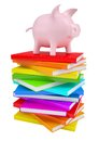 Pink piggy bank on a stack of colorful books Royalty Free Stock Photography