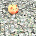 Pink piggy bank standing on a many dollars Royalty Free Stock Photography