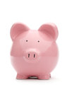 Pink piggy bank on white background Stock Photos