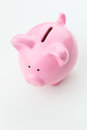 Pink piggy bank on white background a ceramic over a plain viewed from the top Royalty Free Stock Photo