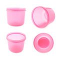 Pink plastic beaker cup isolated over the white background Royalty Free Stock Photo