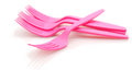 Pink plastic forks  on white background Royalty Free Stock Image