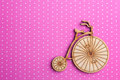 Pink polka dot background with bike Royalty Free Stock Photo