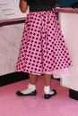 Pink polka dotted poodle skirt Royalty Free Stock Photo