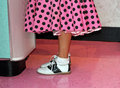 Pink poodle skirt and saddle shoes Royalty Free Stock Photo