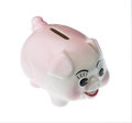 Pink pottery piggy bank isolated against white clipping path Stock Photos