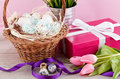 Pink present and colorful tulips festive easter decoration Royalty Free Stock Image
