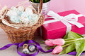 Pink present and colorful tulips festive easter decoration Stock Images