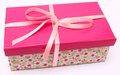 Pink present with a flower base box with a ribbon Stock Photography