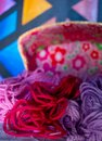 Pink and purple balls wool in wicker basket Royalty Free Stock Photo